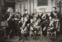 The End of an Era: The Nine Sovereigns at Windsor for the funeral of King Edward VII. Standing, from left to right: King Haakon VII of Norway, Tsar Ferdinand of Bulgaria, King Manuel II of Portugal, Kaiser Wilhelm II of the German Empire, King George I of Greece, and King Albert I of Belgium. Seated, from left to right: King Alfonso XIII of Spain, King-Emperor George V of the United Kingdom, and King Frederick VIII of Denmark. (Wikimedia Commons)